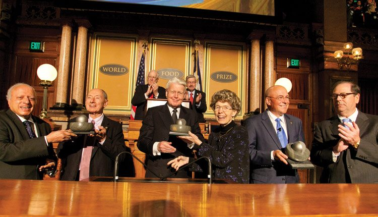 The 2013 World Food Prize was presented in Des Moines, Iowa. Pictured left to right are: M.S. Swaminathan, the first World Food Prize laureate and now chair of the laureate selection committee; 2013 prize winner Marc Van Montagu; Olafur Ragnar Grimsson, president of Iceland; 2013 prize winner Mary-Dell Chilton; 2013 prize winner Robert Fraley; and John Ruan III, chair of the World Food Prize. Photo: World Food Prize.