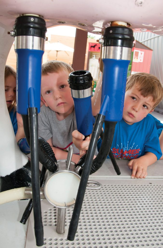 Visitors of the GROW exhibit learn about plant and animal agriculture.