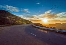 picture of bright sky and winding road